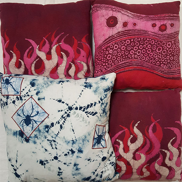 Hooey Batiks   I use melted wax to draw my designs on fabric which resists the color when I dye my material. The waxing and dyeing can be repeated many times for multiple colors and varied designs. After 25 years I'm still having fun making a mess and splashing around in dye! — Jill Miller   www.hooeybatiks.com