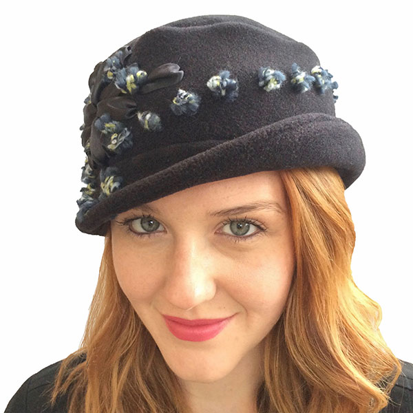 Strong Wear   My hats are all about travel. I want to look good, be comfortable and have my hats work in many different situations. Keeping you dry in the rain, earflaps for the cold and all machine washable.  That's Strong Wear! — Kate Strong    www.strongwear.com