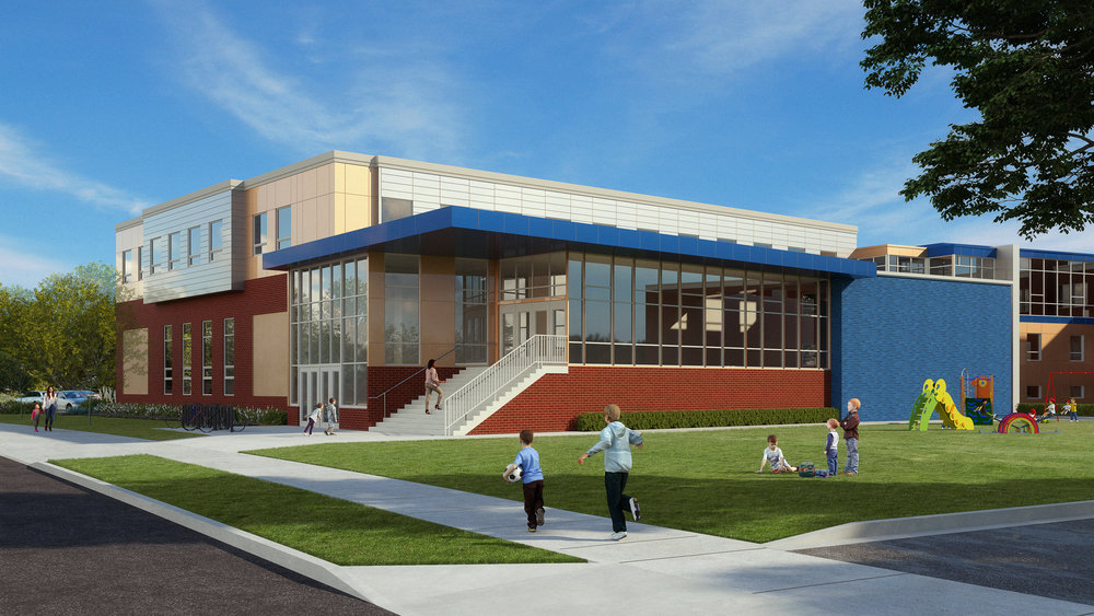 The view from the SE corner of the school's property highlights the cafeteria glazing and increased play area.   The increased daylight in the new cafeteria will be a welcome upgrade from current conditions. The materials are precast concrete panels with red brick inlay, while the metal panels above are the same color and pattern as the 2013 addition. The glazed blue brick between the cafeteria and the 2013 addition is intended to be a backdrop for an art installation. It could showcase work from either known public artists or from TCGIS students. The addition will complement the original school building in height, massing and material selection.