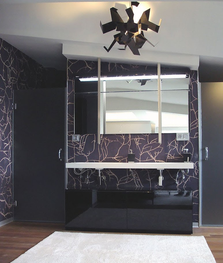 Black glossy vanity, ceiling faucets and white floating countertop