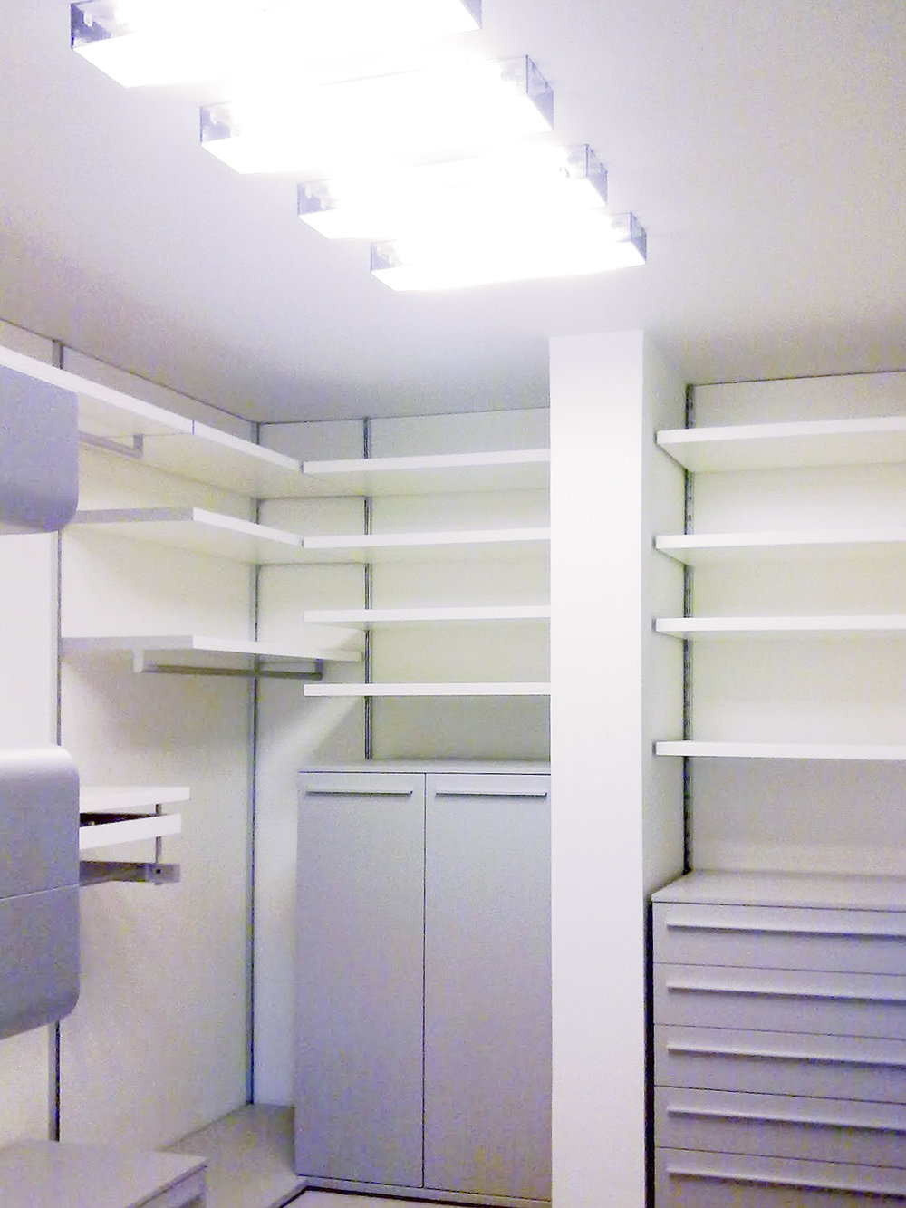 modern walk-in closet cabinets with surface light on ceiling