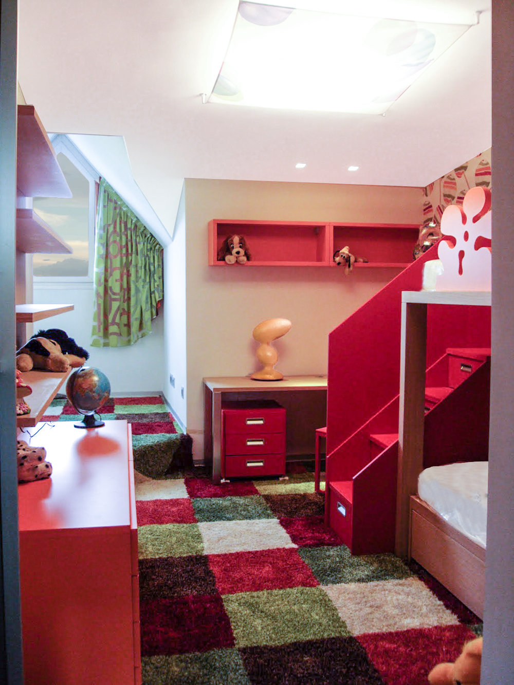 kids bedroom with bunk bed and colorful square carpet