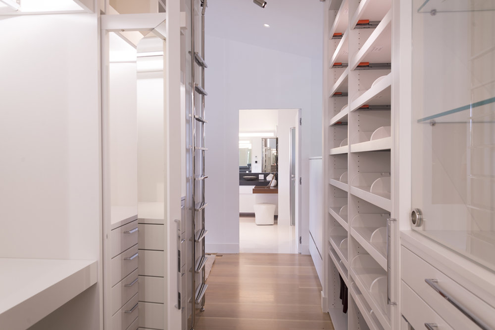 walk-in closet lacquered and light wood