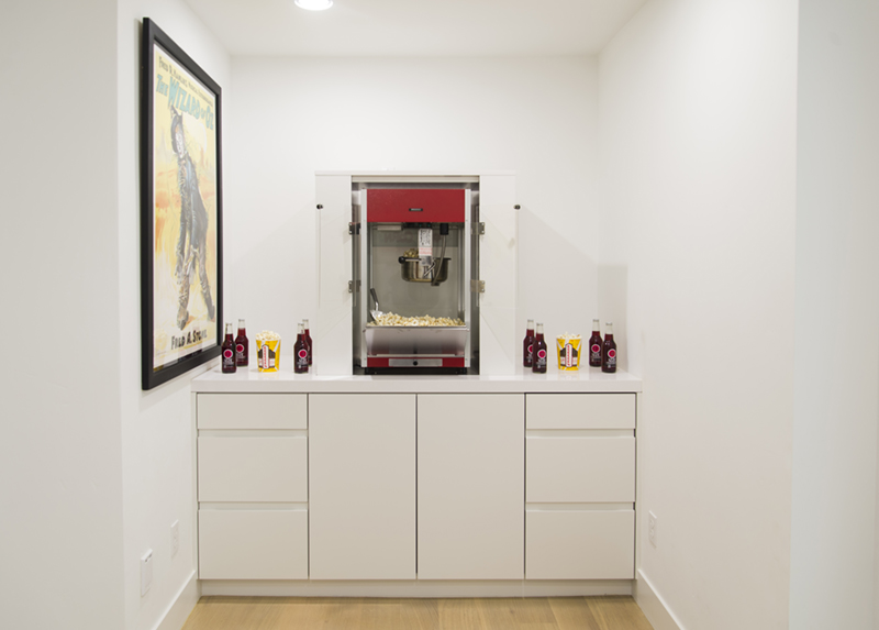 white cabinets with a popcorn machine
