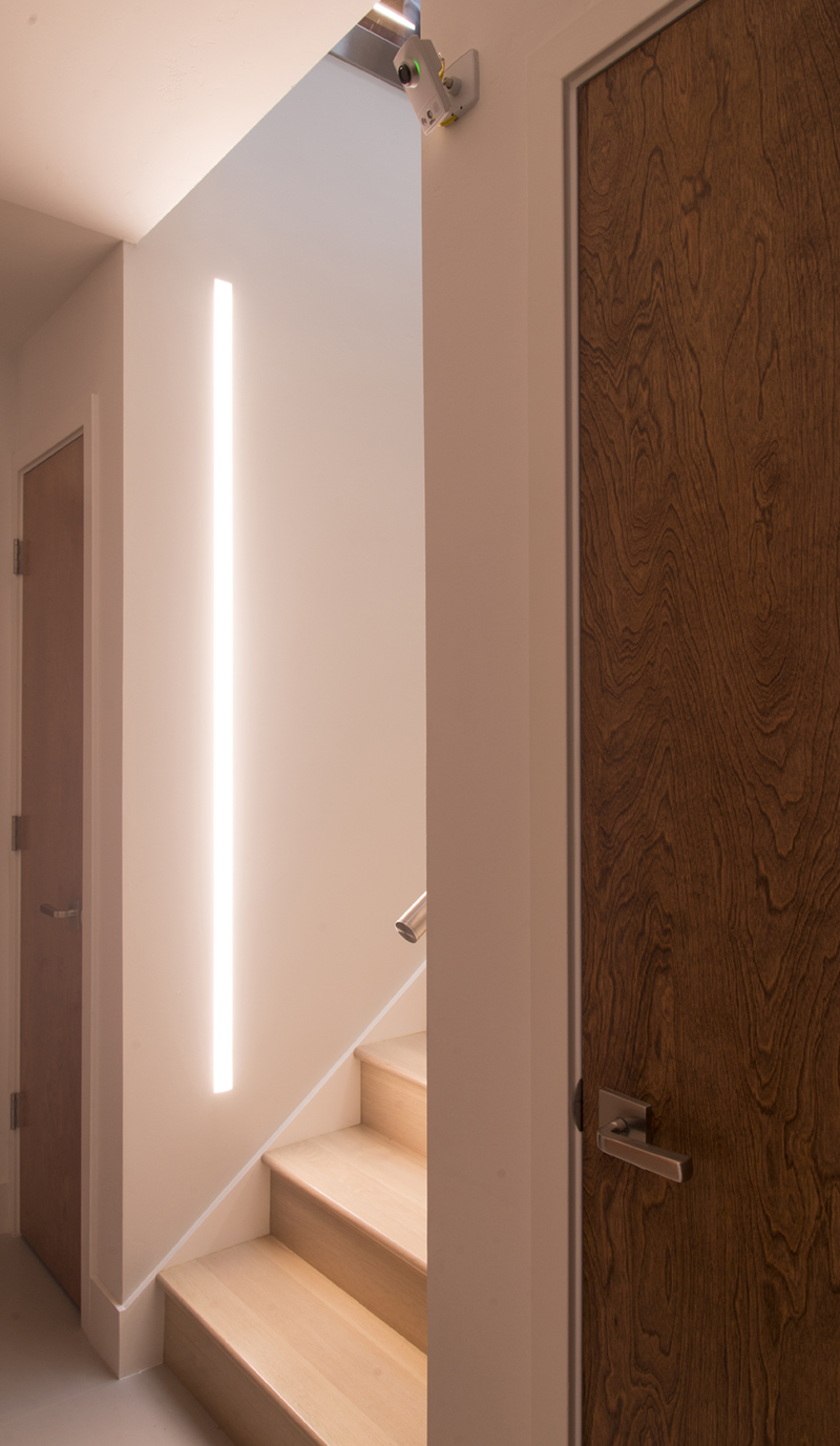 vertical recessed light in a wood staircase