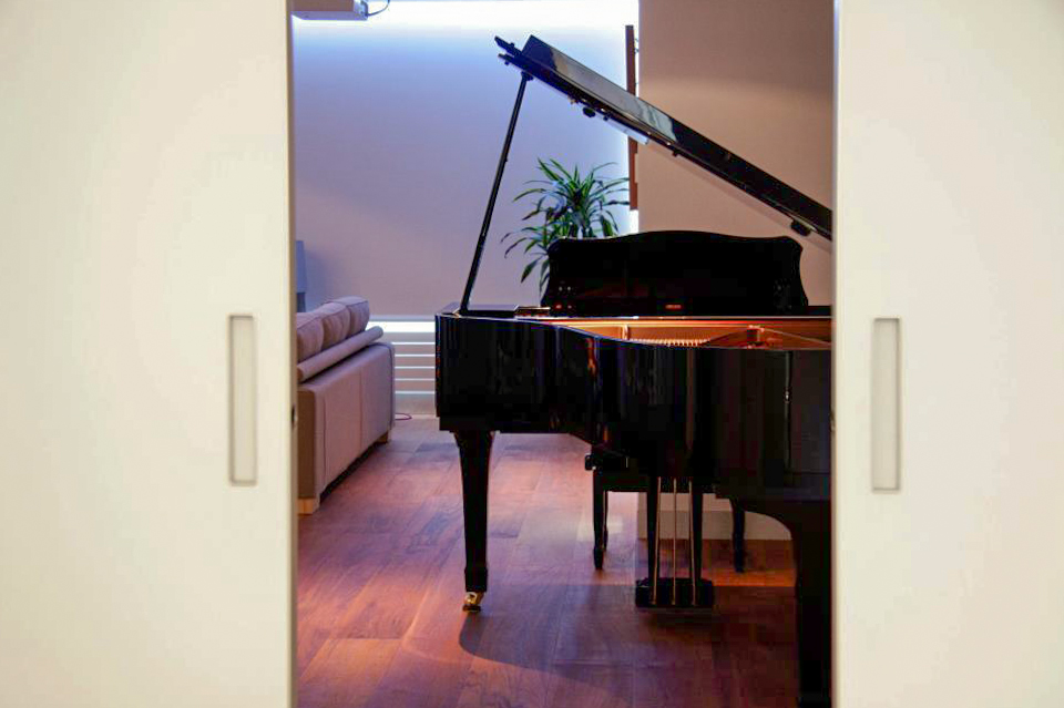 black piano over walnut hardwood floor