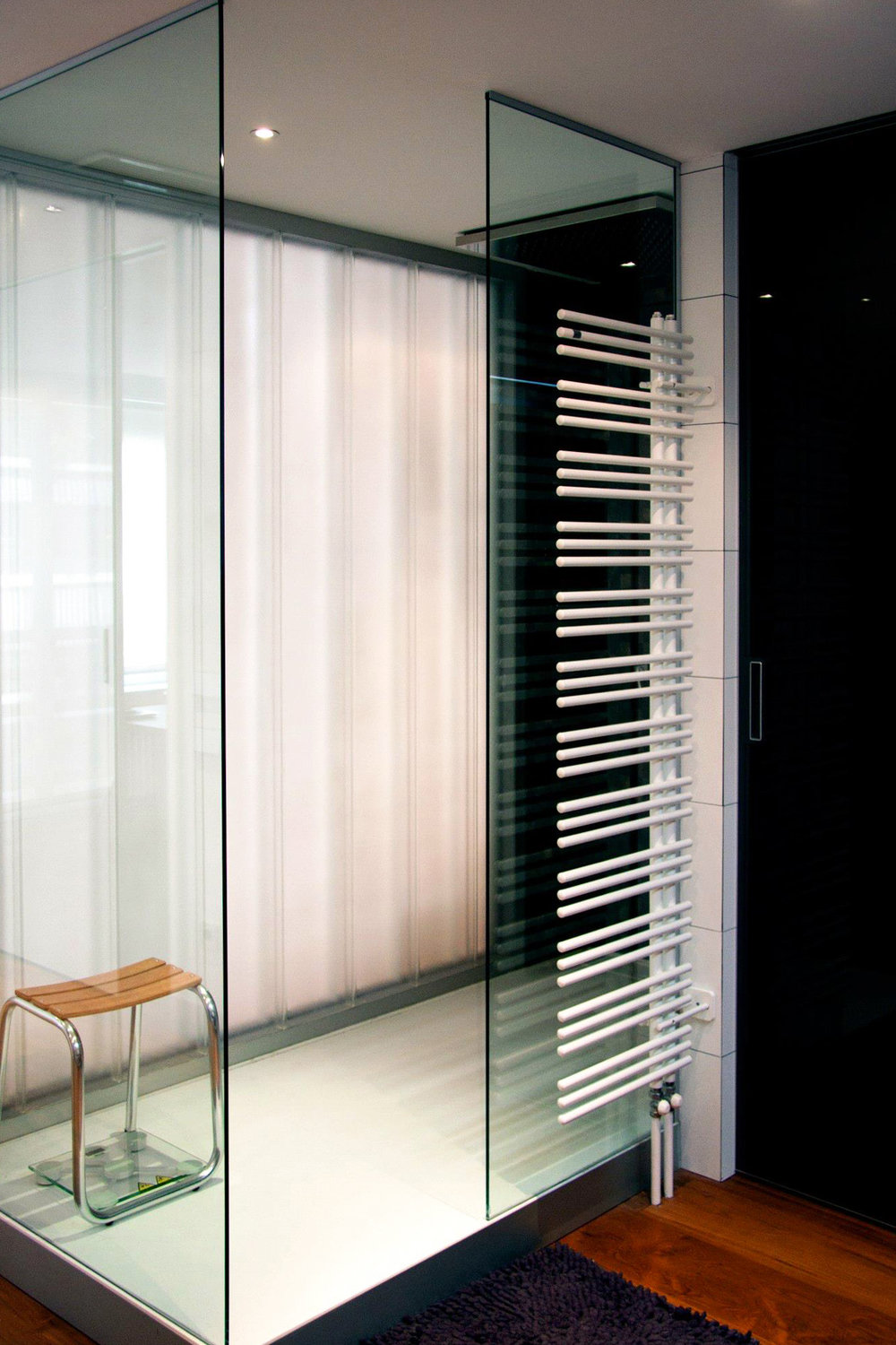 glass walls shower with towel heater