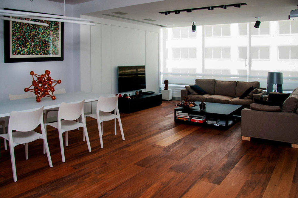 walnut floor in a modern living room with brown sofas