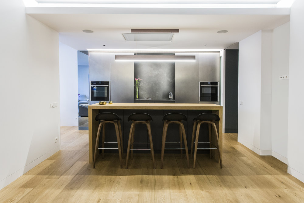 modern kitchen island with oak bar