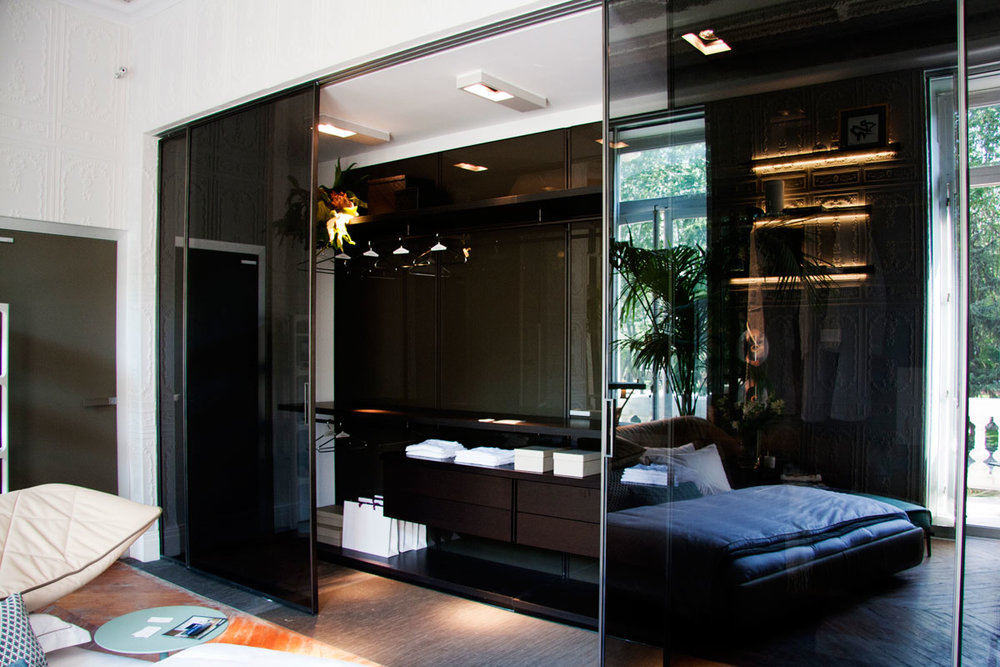 Walk In closet with glass sliding doors