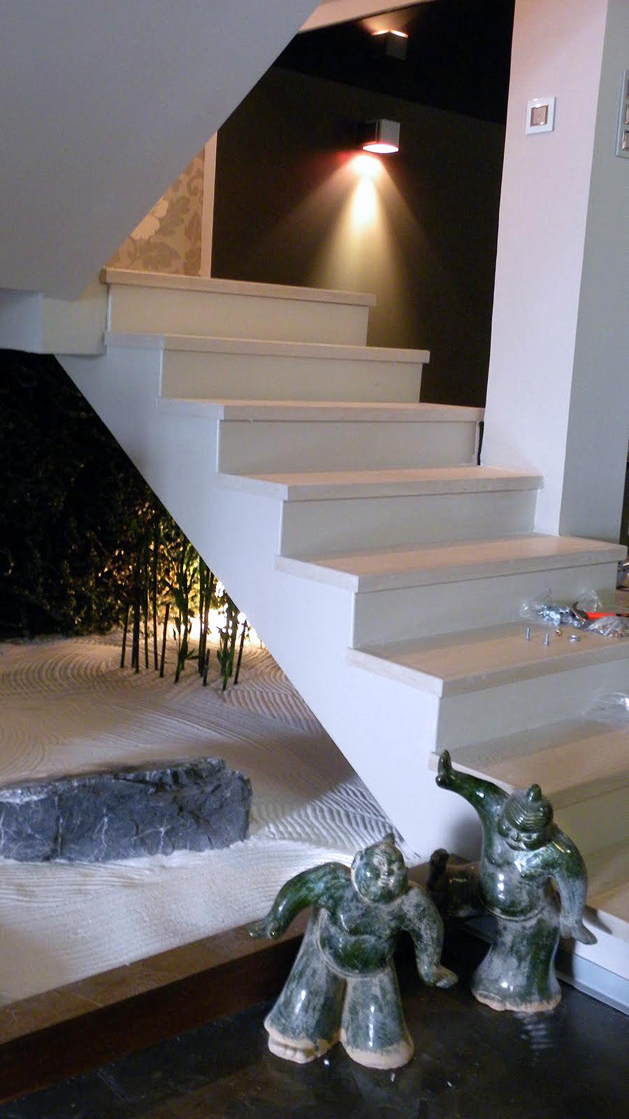 Staircase with a zen garden under it