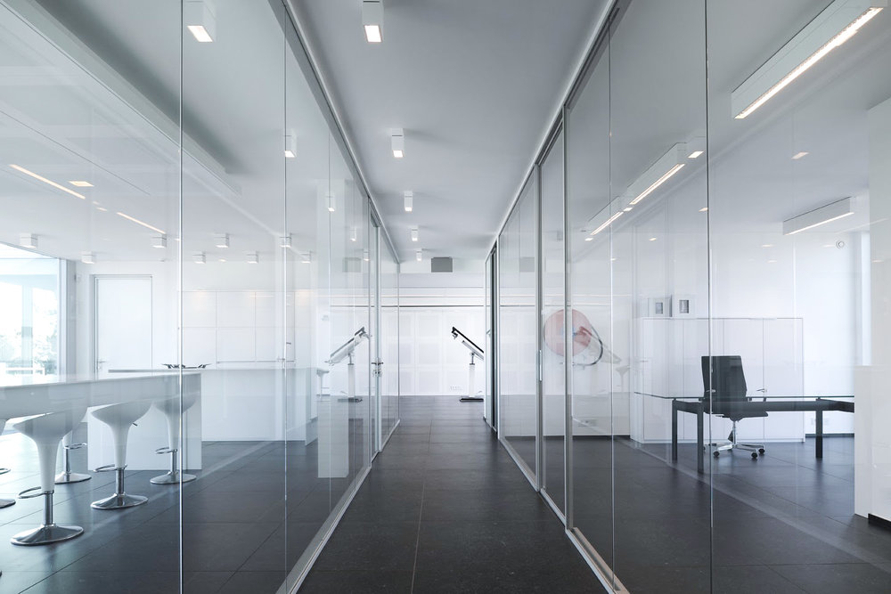 modern office hallway with big glass windows