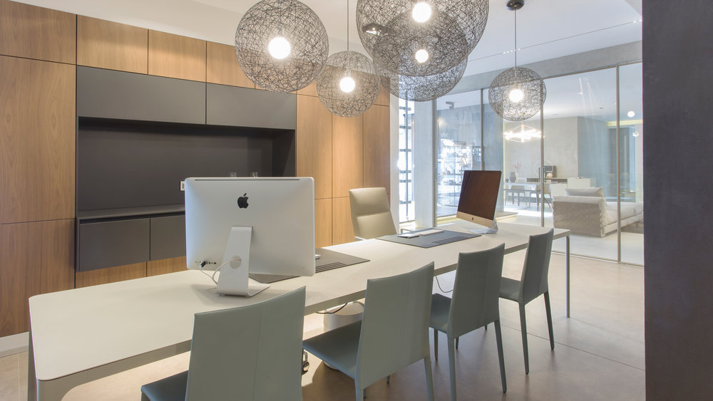 office table with macbooks and leather chairs