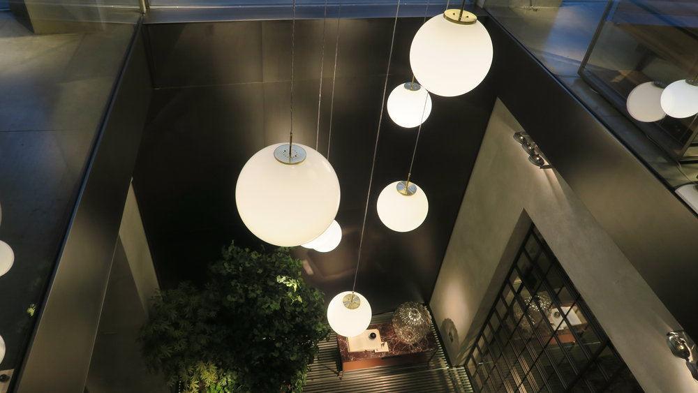 white pendant lights over entry