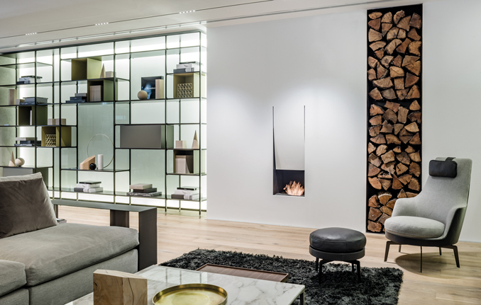modern lobby area with fireplace and bookcase