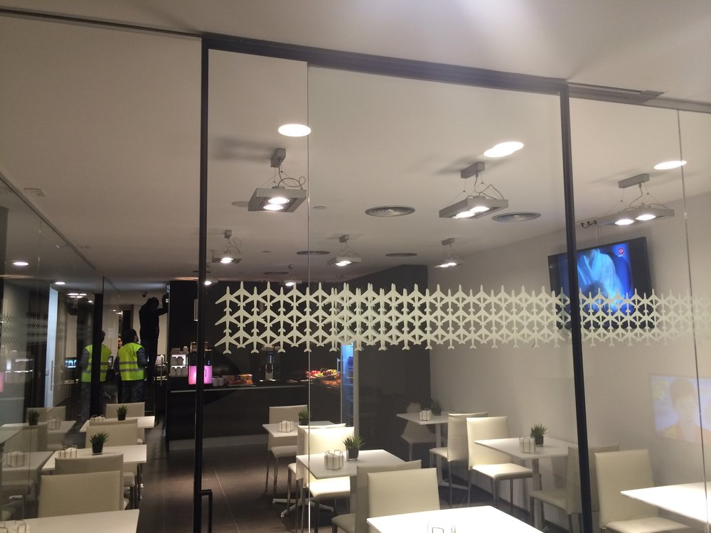 private meeting room enclosed with glass sliding panels