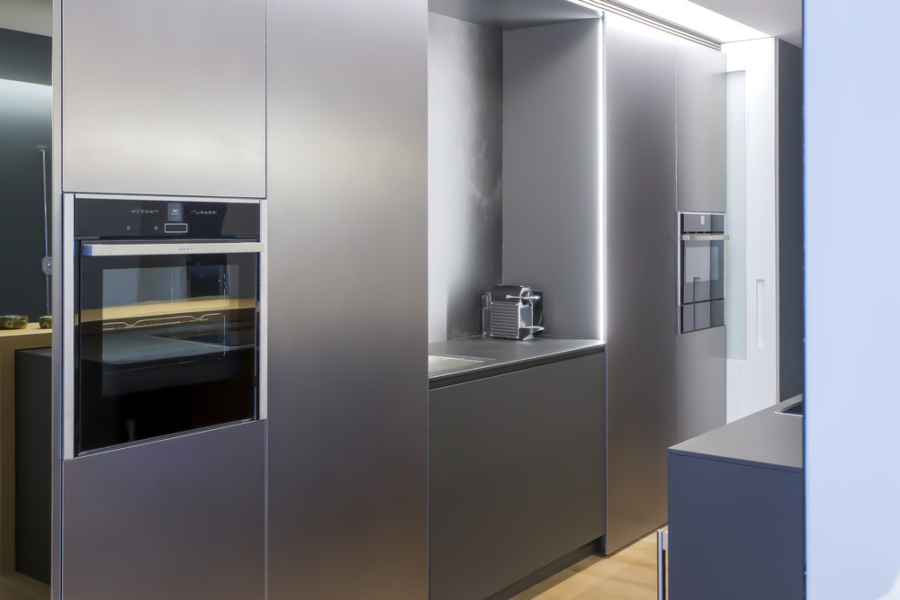 Metallic finish kitchen cabinets with oven and sink