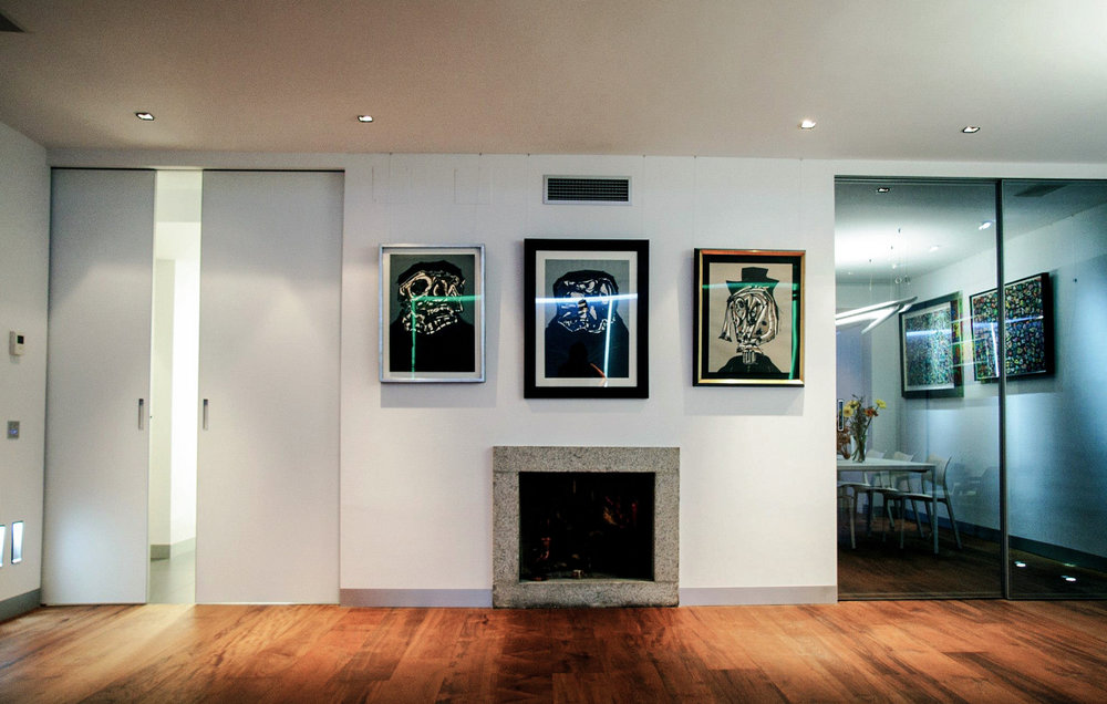 the fireplace wall works now as art gallery feautiring rimadesio sliding panels.