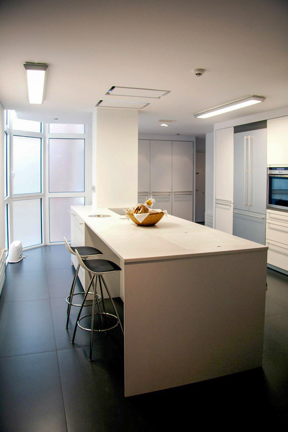 the kitchen island included a faucet that retracts and hide under a corian lid.