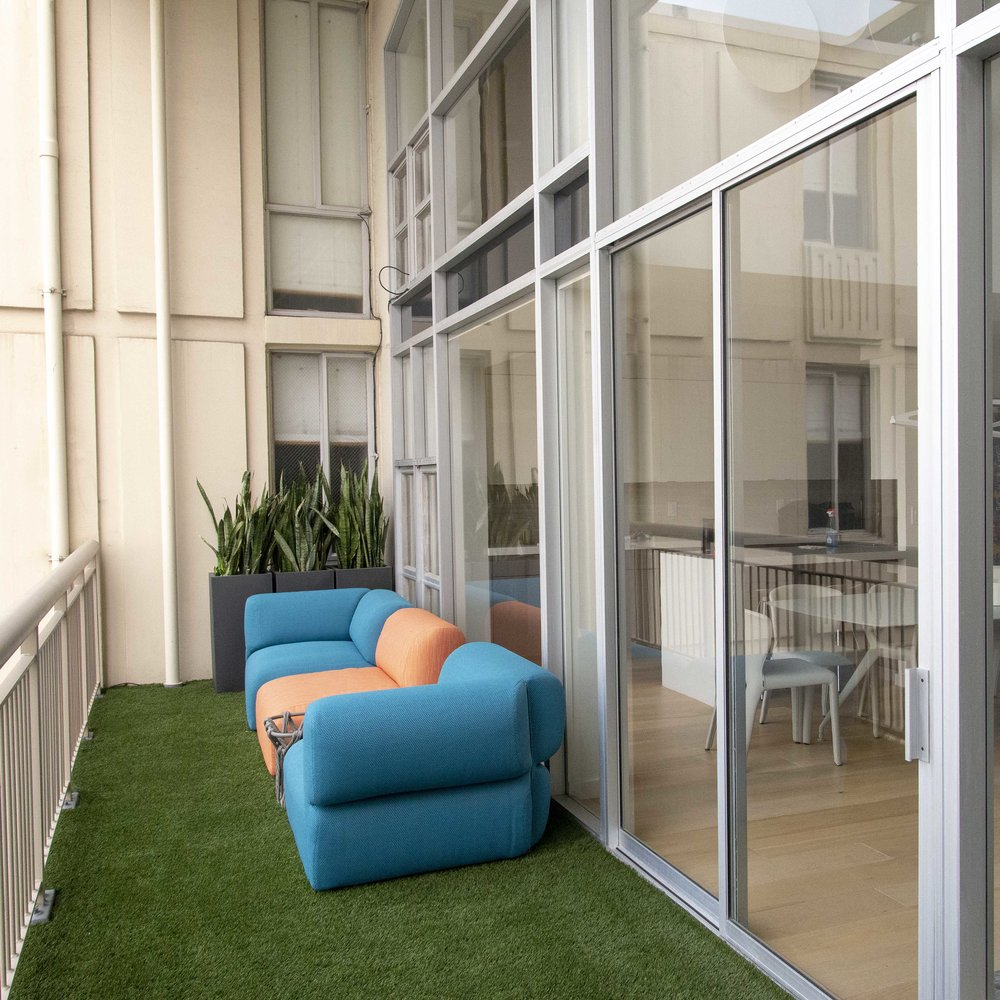 We complemented the balcony with  B&B Italia Butterfly Sofa  designed by Patricia Urquiola and planters from  CB2 .