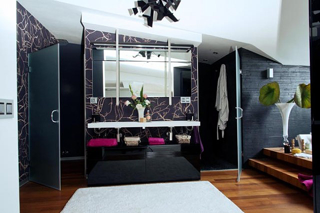 Branches over a dark background for this master bathroom.