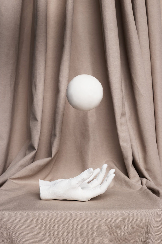 Plaster Hand + Ball  Set: La Cueva Studio & Marcela Luna  Photo: Erika Anes