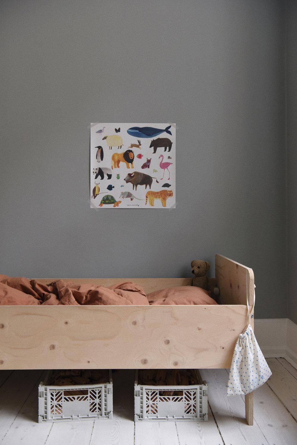 Under the  'Animals' poster  sits Walter's toddler bed, created by Dutch designer  Piet Hein Eek .  Storage boxes  are used under the bed for toys.  Bed linen  in colour Caramel.