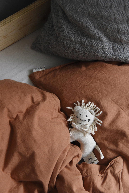 Organic bed linen  and the  Mini Rattle  from Leo Leo Copenhagen.