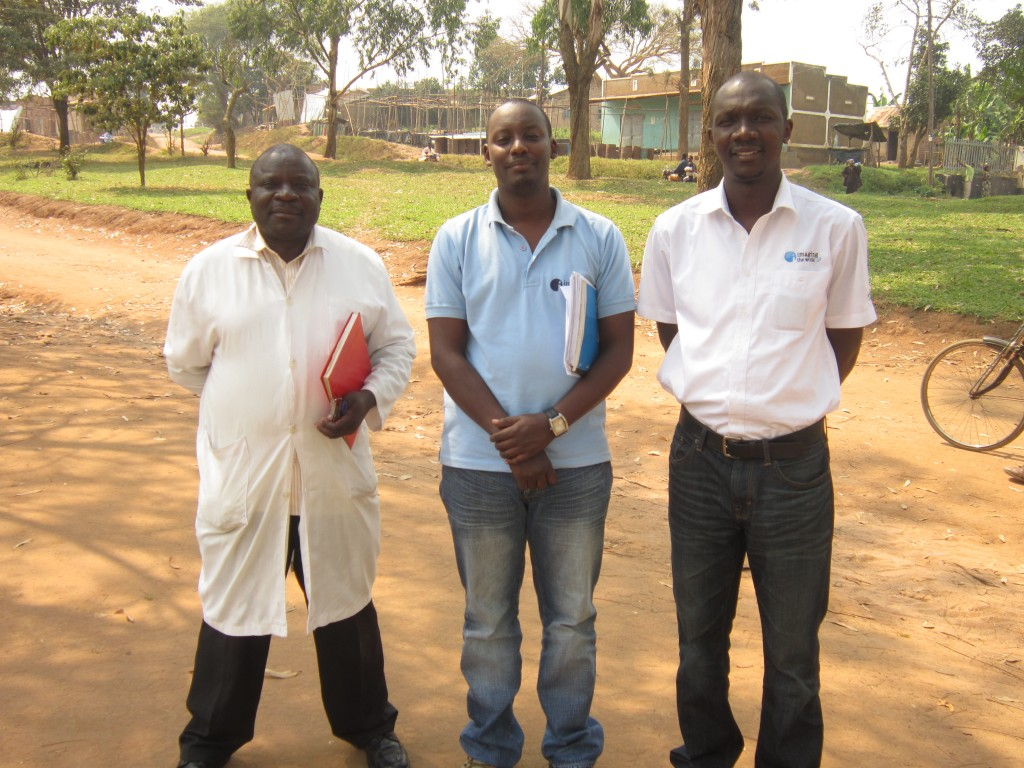 ITWA team pose for a photo with Kiwalabye John the senior clinical officer.