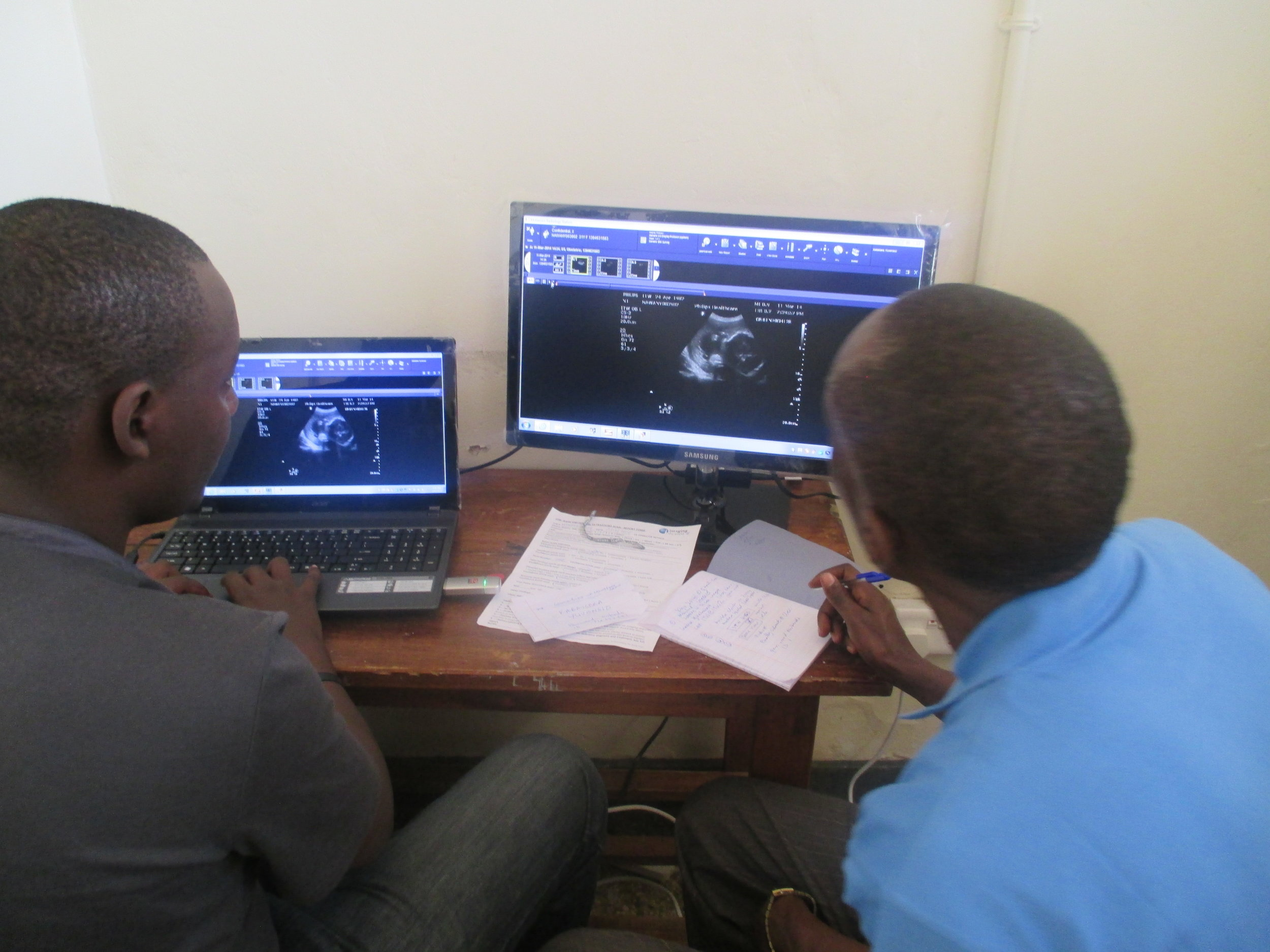 Reviewing images electronically sent securely from Kasambya to Mubende Hospital. All patient information is confidential in the ITW system.