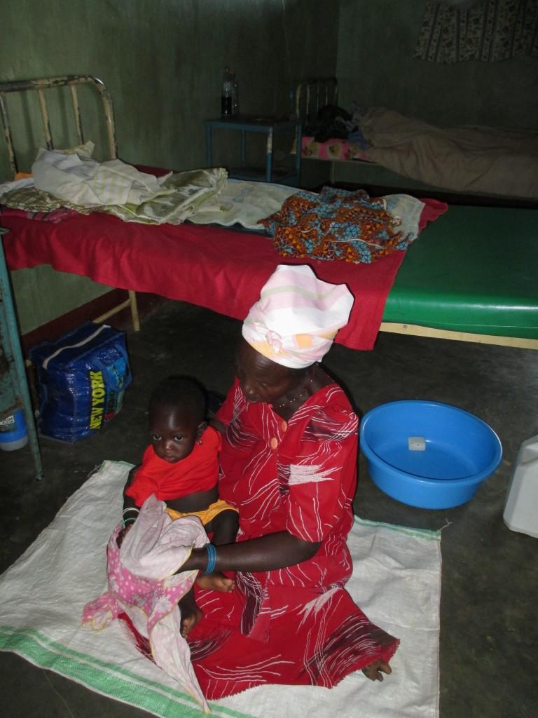 woman malaria baby