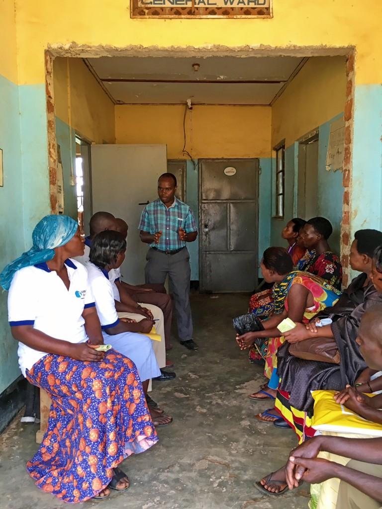 Dr. Alphons Matovu speaks with VHTs at Kasambya Health Center III about the RHD program.