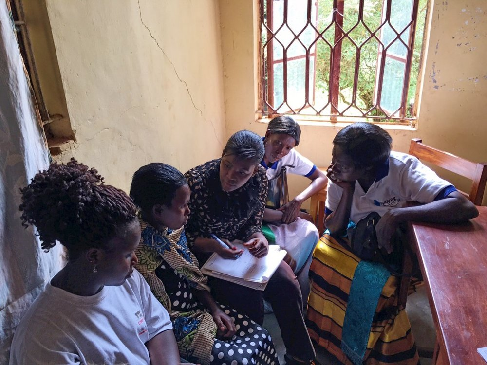 Consenting pregnant women for the RHD study as the VHTs look on and ask questions. The VHTs are the community liaisons.
