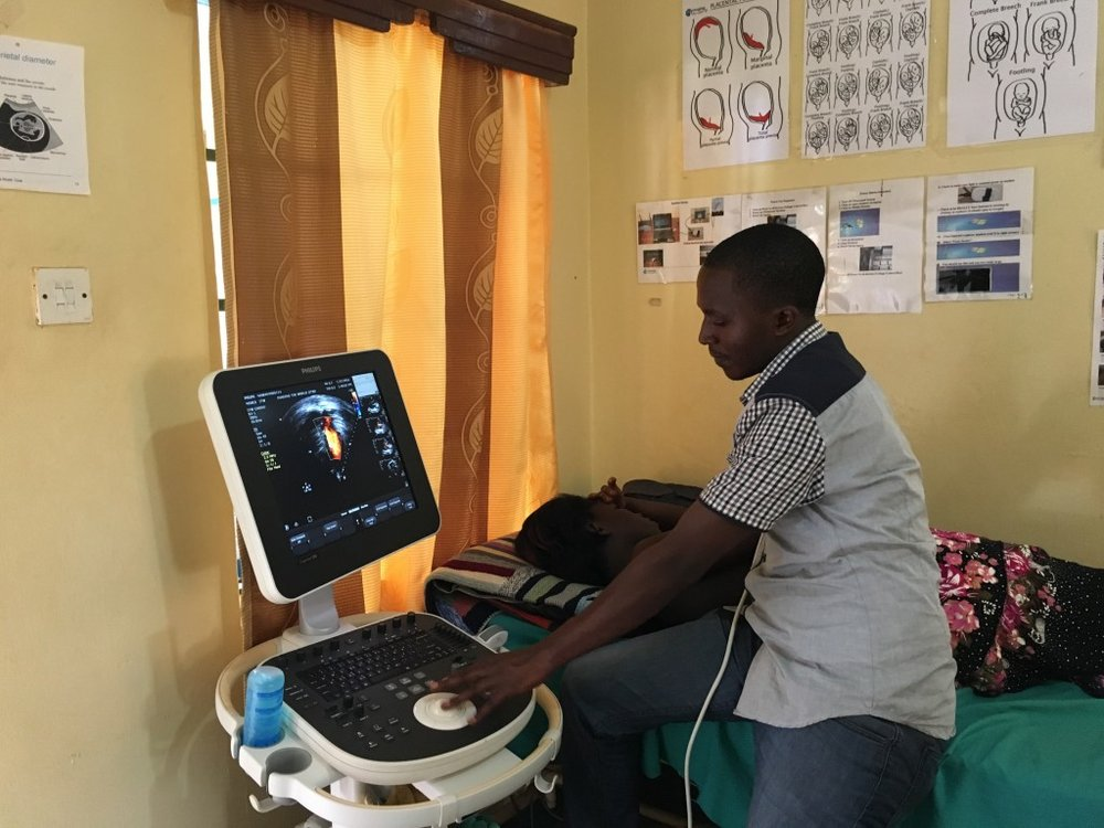 Moses doing an echocardiogram. Note we are able to use the same ultrasound system that we use for OB and other scans; just a different transducer.