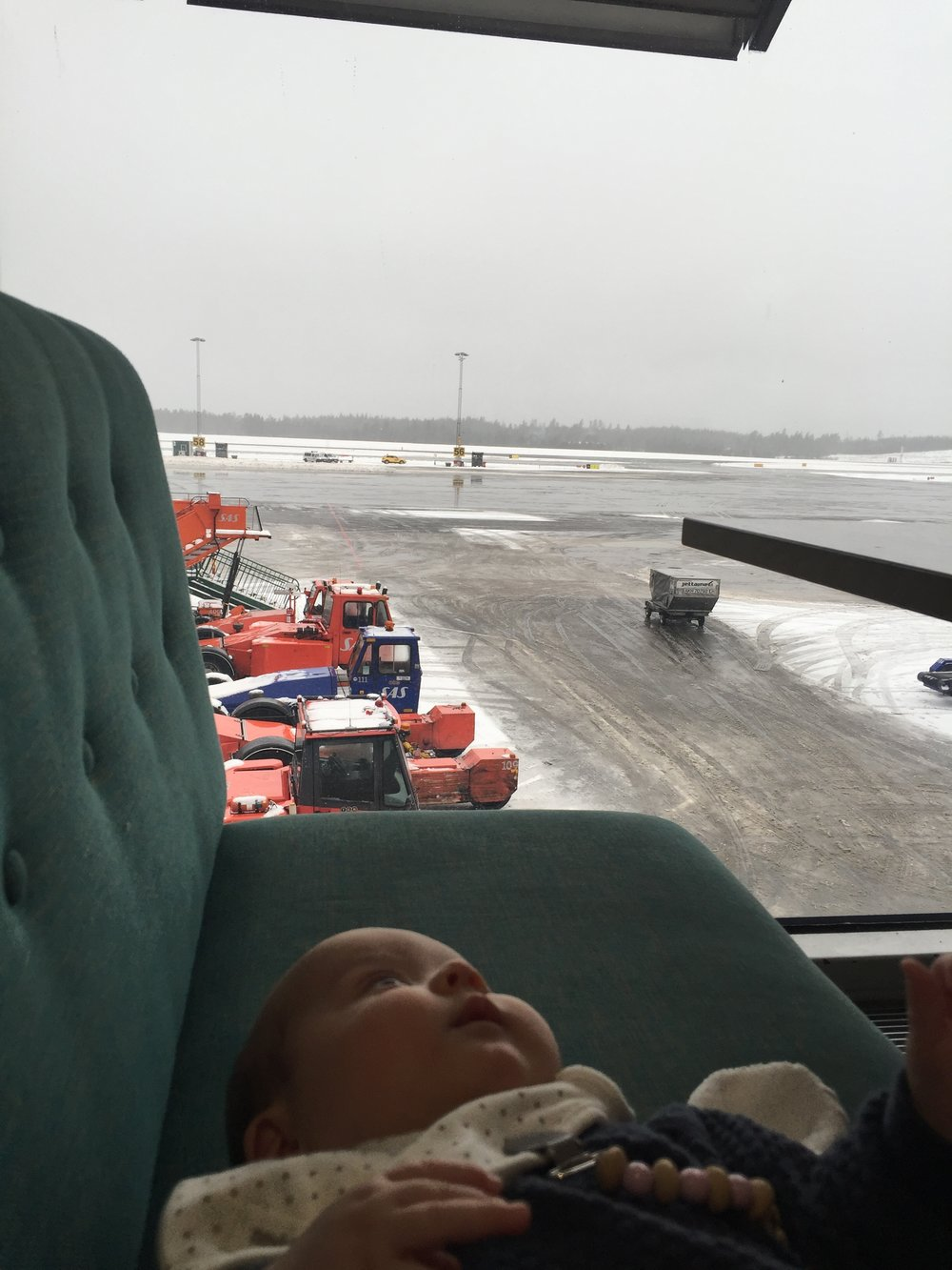Waiting for one of her first flights when she still didn't like to hang out in the baby carrier