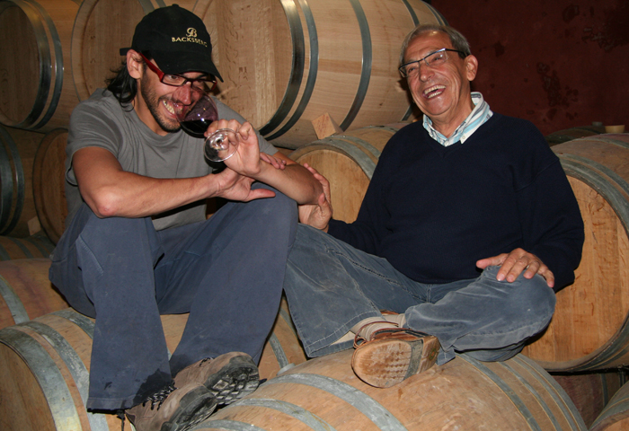 Josep Lluis and son, Adria Perez, tasting wine at Mas Martinet.