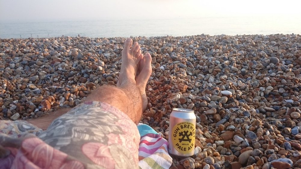 Gun Brewery can on the beach