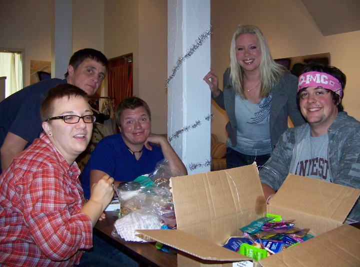 volunqueers making condom kits.png