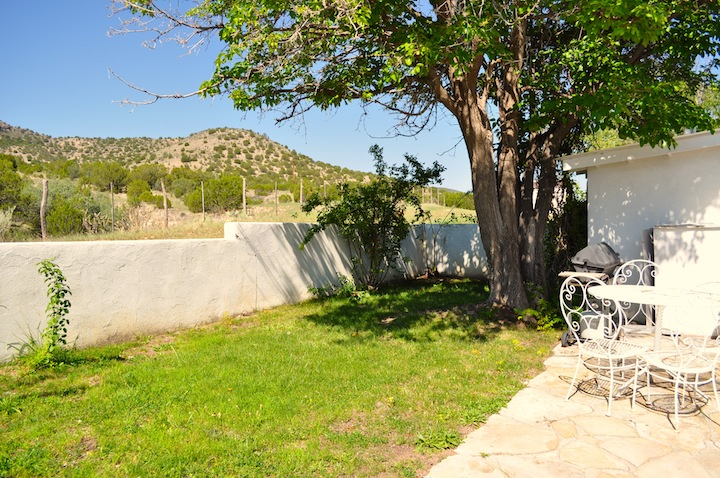Backyard patio for outdoor entertainment; great view of the surronding hills and scenery.