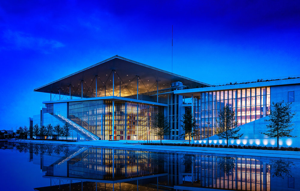 SNF Cultural Center in Kallithea, Greece by Renzo Piano Building Workshop. National Opera  beneath 300' x 300' solar panel covered roof and National Library to right.