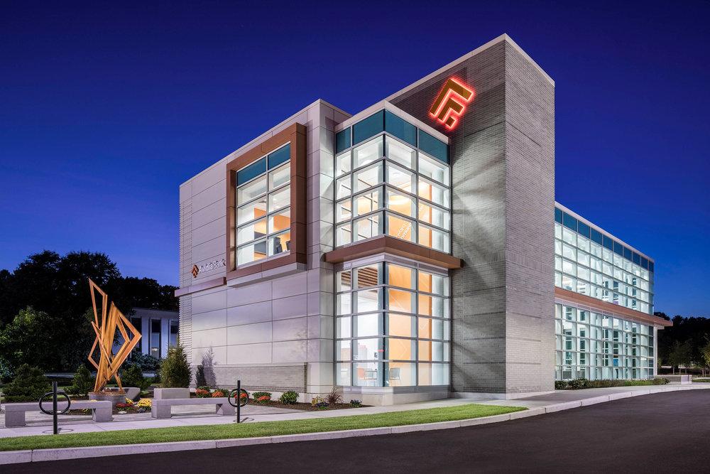 Avidia Bank at dusk in Framingham MA. Architectural designby Studio Q Architecture.