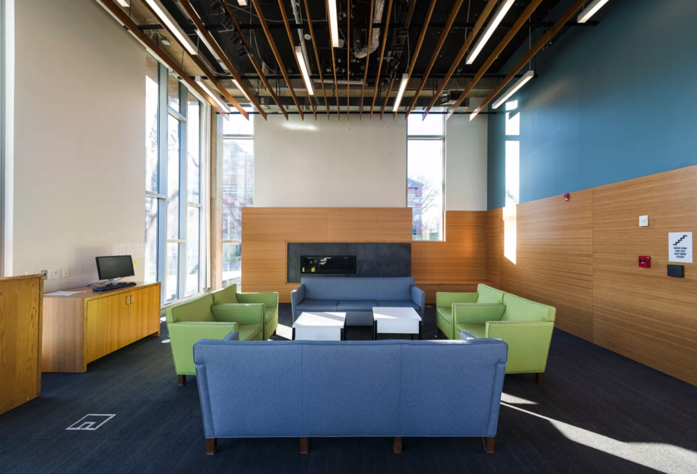 Image description: An image of a room at Gallaudet University, where the couches and chairs are arranged to make it easier for Deaf students who naturally sit in circles when signing.