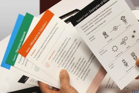 Image description: A person's hands are holding assorted activity cards.