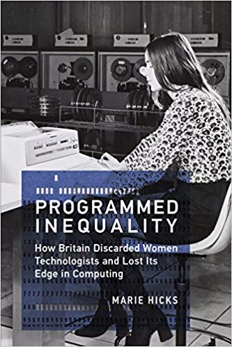 Image description: Book cover for Programmed Inequality: How Britain Discarded Women Technologists and Lost Its Edge in Computing by Marie Hicks. The background image is of a woman sitting at an early computer keyboard. The woman is wearing a long-sleeved print blouse, thigh-length skirt, and heeled boots.