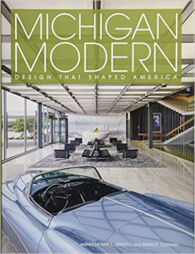 Image description: Book cover for Michigan Modern by Amy Arnold. The cover includes an image of a vintage convertible in the foreground and a lobby area with seating in the background.