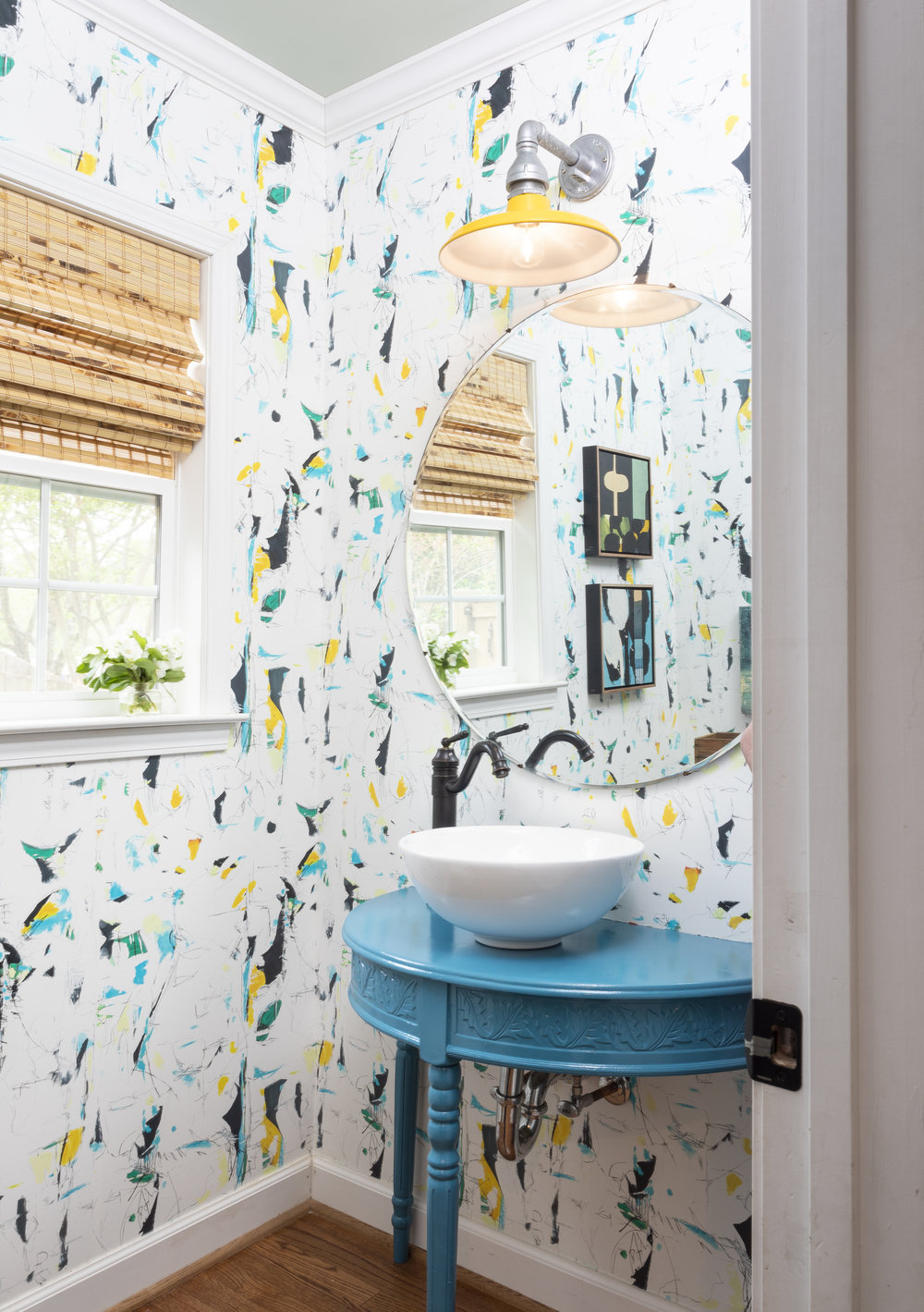 "Teresa Roche 's ""Anchorage Series - Green"" wallpaper hangs in the powder room"