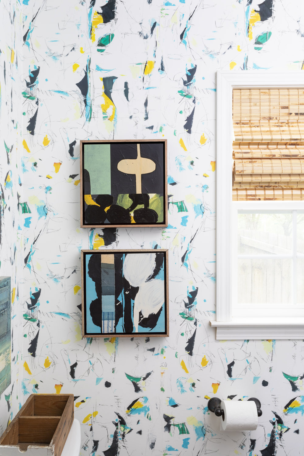 Katie Walker  abstracts bring pair perfectly with this custom wallpaper.