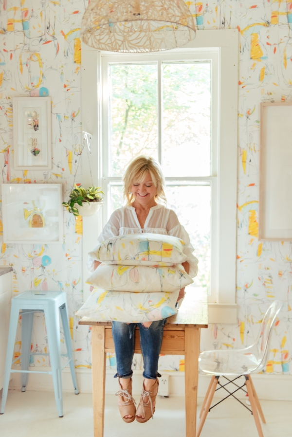 "Roche in the A&L Gallery kitchen featuring her wallpaper, ""Sully's Bouquet"" - Photo by  Luke Cleland"