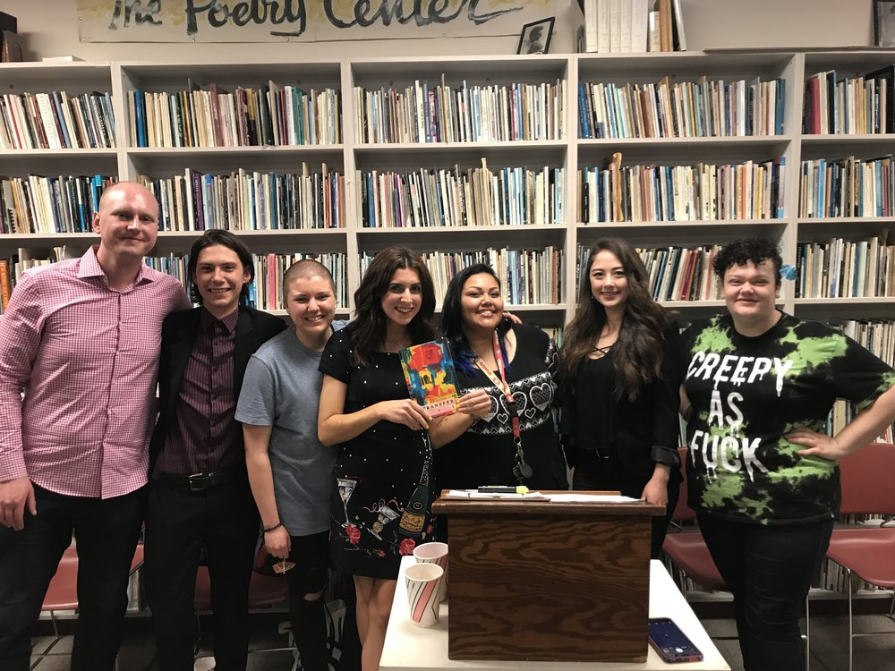 The  Transfer 115  editors at the release party at the Poetry Center (San Francisco State University) in May 2018.    From left to right:  James Giffin (Digital Media Director), Hunter Thomas (Poetry Editor), Bella Rocha (Poetry Editor), Cori Amato Hartwig (Managing Editor), Estrellita Ruiz (Editor In Chief), Laurie Olson (Fiction Editor), and Aleesha Lange (Fiction Editor).