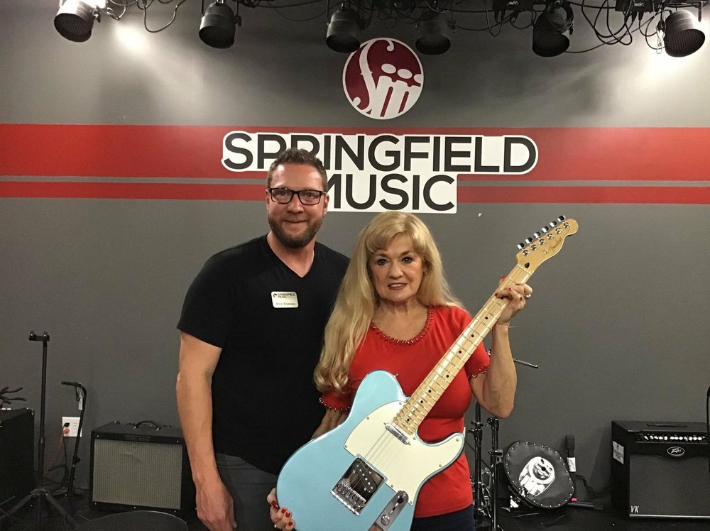 As always, it was an honor to partner with Blues Society Of The Ozarks to raffle off this beautiful guitar to the equally-beautiful Pattie Hays! Congratulations! - Much gratitude to Springfield Music and Fender Guitars for donating the beautiful Telecaster for the Blues in the Schools fundraiser this year! All the proceeds go to the successful on going BITS program that George Hunt and Bob Bledsoe conduct in Public Schools but also at  the Division of Youth Services and other youth facilities. Its amazing to think that over 600 kids have received a harmonica within the last year have learned how to play it, learned 12 bar blues, history of blues music and written songs.Thanks to all who bought tickets this year!